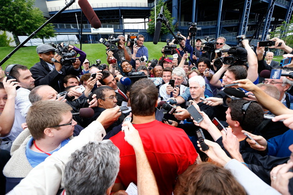 FOXBORO, MA - JUNE 11: Tim Tebow #5 of the New England Patriots talks to reporters following minicamp at Gillette Stadium on June 11, 2013 in Foxboro, Massachusetts. (Photo by Jared Wickerham/Getty Images)