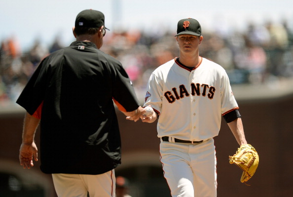 SAN FRANCISCO, CA - JULY 10:  Manager Bruce Bochy #15 of the San Francisco Giants takes the ball from pitcher Matt Cain taking him out of the game in the first inning against the New York Mets at AT&T Park on July 10, 2013 in San Francisco, California. Cain only pitched two thirds of an inning. (Photo by Thearon W. Henderson/Getty Images)