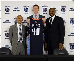 Jun 28, 2013; Charlotte, NC, USA; Charlotte Bobcats first round draft pick Cody Zeller (middle), general manager Rich Cho (left), and president of basketball operations Rod Higgins (right) hold up jersey  during the introduction press conference at Time Warner Arena. Mandatory Credit: Curtis Wilson-USA TODAY Sports
