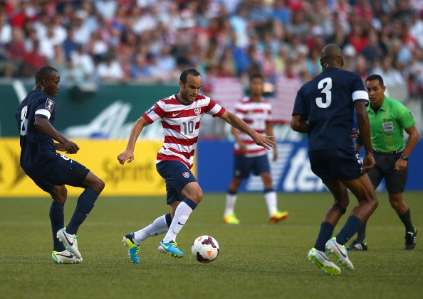 PORTLAND, OR - JULY 09:  Landon Donovan #10 of the United States dribbles the ball against Trevor Lennen #3 and Elroy Smith #8 Belize during the 2013 CONCACAF Gold Cup on July 9, 2013 at Jeld-Wen Field in Portland, Oregon.  (Photo by Jonathan Ferrey/Getty Images)