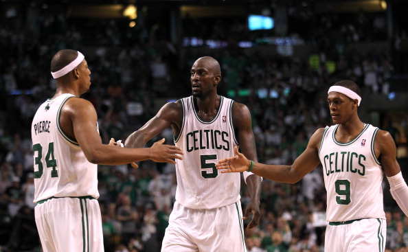 BOSTON, MA - JUNE 03:  (L-R) Paul Pierce #34, Kevin Garnett #5 and Rajon Rondo #9 of the Boston Celtics celebrate a play against the Miami Heat in Game Four of the Eastern Conference Finals in the 2012 NBA Playoffs on June 3, 2012 at TD Garden in Boston, Massachusetts. The Celtics won 93-91. NOTE TO USER: User expressly acknowledges and agrees that, by downloading and or using this photograph, User is consenting to the terms and conditions of the Getty Images License Agreement.  (Photo by Jim Rogash/Getty Images)