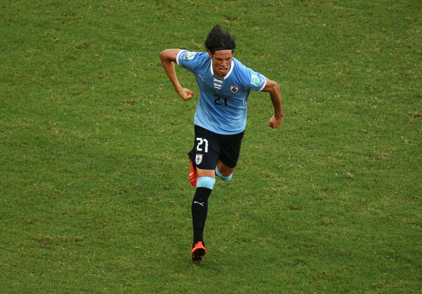SALVADOR, BRAZIL - JUNE 30:  Edinson Cavani of Uruguay celebrates scoring his team's second goal to make the score 2-2 during the FIFA Confederations Cup Brazil 2013 3rd Place match between Uruguay and Italy at Estadio Octavio Mangabeira (Arena Fonte Nova Salvador) on June 30, 2013 in Salvador, Brazil.  (Photo by Robert Cianflone/Getty Images)