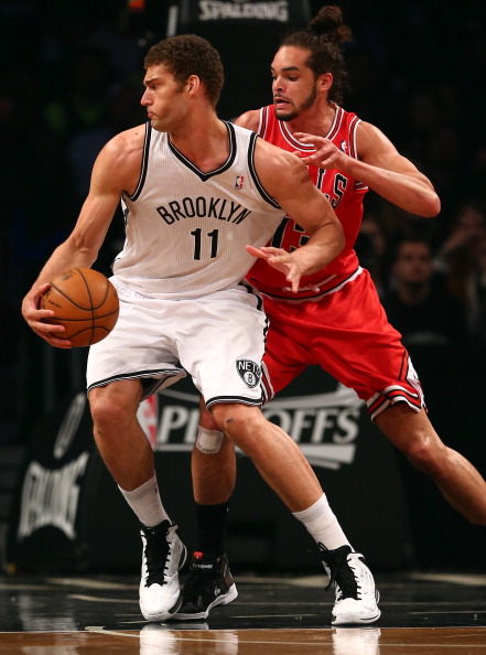 NEW YORK, NY - MAY 04:  Brook Lopez #11 of the Brooklyn Nets tries to get around Joakim Noah #13 of the Chicago Bulls during Game Seven of the Eastern Conference Quarterfinals of the 2013 NBA Playoffs on May 4, 2013 at the Barclays Center in the Brooklyn borough of New York City. NOTE TO USER: User expressly acknowledges and agrees that, by downloading and/or using this photograph, user is consenting to the terms and conditions of the Getty Images License Agreement.  (Photo by Elsa/Getty Images)