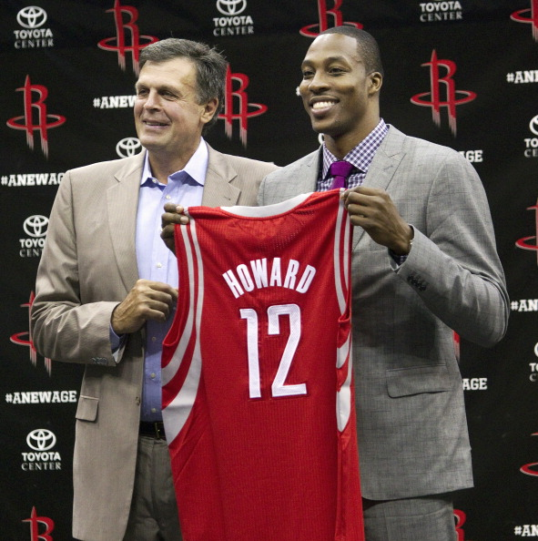 HOUSTON - JULY 13:  Houston Rocktes head coach Kevin McHale (L) and Dwight Howard hold up his new jersey during a press conference on July 13, 2013 in Houston, Texas.  (Photo by Bob Levey/Getty Images)