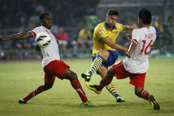 JAKARTA, INDONESIA - JULY 14:  Oliver Giroud of Arsenal scores a goal during the match between Arsenal and the Indonesia All-Stars at Gelora Bung Karno Stadium on July 14, 2013 in Jakarta, Indonesia.  (Photo by Ulet Ifansasti/Getty Images)