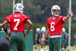 Jun 11, 2013; Florham Park, NJ, USA; New York Jets quarterback Geno Smith (7) and New York Jets quarterback Mark Sanchez (6) during the New York Jets minicamp session at the Atlantic Health Jets Training Center.  Mandatory Credit: Ed Mulholland-USA TODAY Sports
