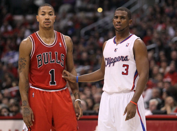 LOS ANGELES, CA - DECEMBER 30: Derrick Rose #1 of the Chicago Bulls and Chris Paul #3 of the Los Angeles Clippers set for a play at Staples Center on December 30, 2011 in Los Angeles, California.   NOTE TO USER: User expressly acknowledges and agrees that, by downloading and or using this photograph, User is consenting to the terms and conditions of the Getty Images License Agreement.  (Photo by Stephen Dunn/Getty Images)