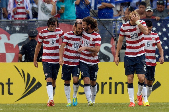 BALTIMORE, MD - JULY 21:  Kyle Beckerman #14 celebrates with Landon Donovan #10 of the United States after Mix Diskerud #8 scored a goal in the second half against El Salvador during the 2013 CONCACAF Gold Cup quarterfinal game at M&T Bank Stadium on July 21, 2013 in Baltimore, Maryland.  (Photo by Patrick McDermott/Getty Images)