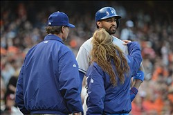 July 5, 2013; San Francisco, CA, USA; Los Angeles Dodgers center fielder Matt Kemp (27) is looked at by manager Don Mattingly (left) and head trainer Sue Falsone (right, front) during the second inning against the San Francisco Giants at AT&T Park. Mandatory Credit: Kyle Terada-USA TODAY Sports