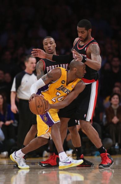 LOS ANGELES, CA - FEBRUARY 22:  Kobe Bryant #24 of the Los Angeles Lakers is defended by LaMarcus Aldridge #12 of the Portland Trail Blazers in the second half at Staples Center on February 22, 2013 in Los Angeles, California. The Lakers defeated the Trail Blazers 111-107. NOTE TO USER: User expressly acknowledges and agrees that, by downloading and or using this photograph, User is consenting to the terms and conditions of the Getty Images License Agreement.  (Photo by Jeff Gross/Getty Images)