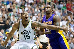 November 7, 2012; Salt Lake City, UT, USA; Utah Jazz power forward Derrick Favors (15) boxes out Los Angeles Lakers power forward Antawn Jamison (4) during the first half at EnergySolutions Arena. Mandatory Credit: Russ Isabella-USA TODAY Sports