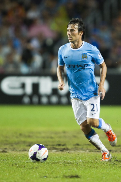 SO KON PO, HONG KONG - JULY 27: David Silva of Manchester City runs with the ball during the Barclays Asia Trophy Final match between Manchester City and Sunderland at Hong Kong Stadium on July 27, 2013 in So Kon Po, Hong Kong.  (Photo by Victor Fraile/Getty Images)