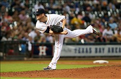Jul 3, 2013; Houston, TX, USA; Houston Astros starting pitcher Bud Norris (20) pitches during the fourth inning against the Tampa Bay Rays at Minute Maid Park. Mandatory Credit: Troy Taormina-USA TODAY Sports