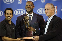May 5, 2013; Miami, FL, USA; Miami Heat small forward LeBron James (center) holds his fourth MVP trohpy next to head coach Erik Spoelstra (left) and Heat president Pat Riley (right) at the American Airlines Arena. Mandatory Credit: Steve Mitchell-USA TODAY Sports