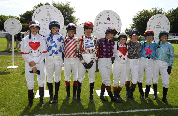 CHICHESTER, ENGLAND - AUGUST 01: The lady jockeys line up for The Magnolia Cup, (L-R) Francesca Cumani, Alexis Green, Lucy Henman, Tricia Simonon, Philippa Holland, Dido Harding, Maggie Buggie, Krissi Murison and Gina Bryce at Goodwood racecourse on August 01, 2013 in Chichester, England. (Photo by Alan Crowhurst/Getty Images)
