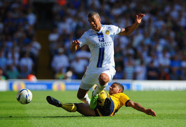 LEEDS, ENGLAND - AUGUST 03:  Lee Peltier of Leeds in action with Liam Bridcutt of Brighton during the Sky Bet Championship match between Leeds United and Brighton & Hove Albion at Elland Road on August 03, 2013 in Leeds, England,  (Photo by Michael Regan/Getty Images)