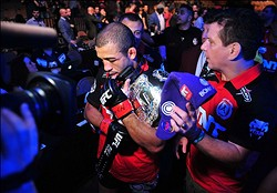Feb 2, 2013; Las Vegas, NV, USA; Jose Aldo with his team during UFC 156 at the Mandalay Bay Events Center. Mandatory Credit: Gary A. Vasquez-USA TODAY Sports