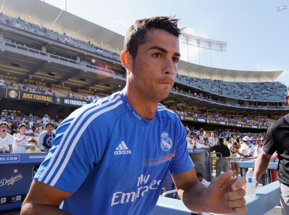 LOS ANGELES, CA - AUGUST 03:  Cristiano Ronaldo #7 of Real Madrid enters the field from the Los Angeles Dodgers dugout prior to the start of the soccer match against Everton in the 2013 Guinness International Champions Cup at Dodger Stadium on August 3, 2013 in Los Angeles, California. For the first time ever a doubleheader soccer match involving three European soccer clubs, Real Madrid, Everton and Juventus, and a team from Major League Soccer, Los Angeles Galaxy, will play on the baseball field where the Los Angeles Dodgers play their home baseball games.  (Photo by Kevork Djansezian/Getty Images)