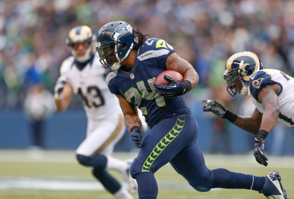 SEATTLE, WA - DECEMBER 30:  Running back Marshawn Lynch #24 of the Seattle Seahawks rushes against the St. Louis Rams at CenturyLink Field on December 30, 2012 in Seattle, Washington.  (Photo by Otto Greule Jr/Getty Images)