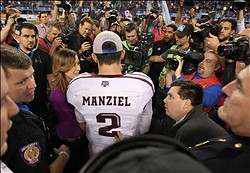 Jan 4, 2013; Arlington, TX, USA; Texas A&M Aggies quarterback Johnny Manziel (2) talks to the media after the game against the Oklahoma Sooners during the Cotton Bowl at Cowboys Stadium. Texas A&M beat Oklahoma 41-13. Mandatory Credit: Tim Heitman-USA TODAY Sports