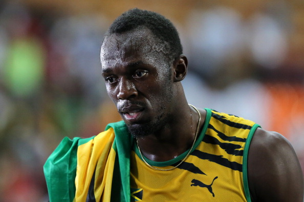 MOSCOW, RUSSIA - AUGUST 11:  Usain Bolt of Jamaica wins gold in the Men's 100 metres Final during Day Two of the 14th IAAF World Athletics Championships Moscow 2013 at Luzhniki Stadium on August 11, 2013 in Moscow, Russia.  (Photo by Ian Walton/Getty Images)
