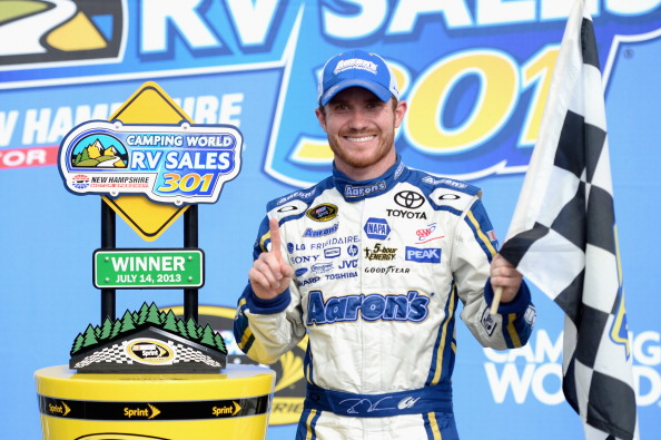 LOUDON, NH - JULY 14: Brian Vickers, driver of the #55 Aaron's Dream Machine Toyota, celebrate in victory lane during the NASCAR Sprint Cup Series Camping World RV Sales 301 at New Hampshire Motor Speedway on July 14, 2013 in Loudon, New Hampshire.  (Photo by Patrick Smith/Getty Images)