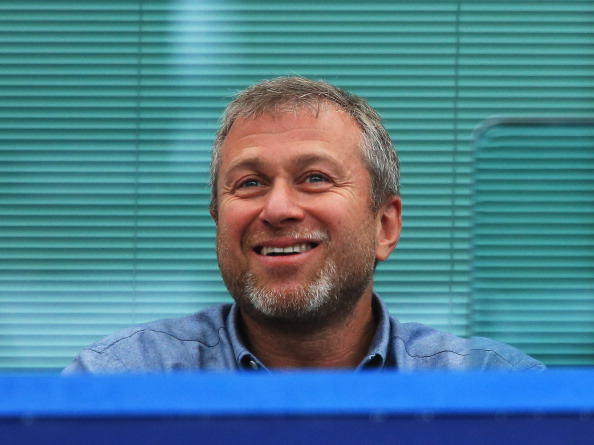LONDON, ENGLAND - AUGUST 18: Chelsea owner Roman Abramovich smiles during the Barclays Premier League match between Chelsea and Hull City at Stamford Bridge on August 18, 2013 in London, England.  (Photo by Richard Heathcote/Getty Images)