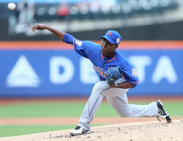 NEW YORK, NY - JULY 14:  Rafael Montero #45 of the World Team delivers a pitch to the United States team in the first inning on July 14, 2013 at Citi Field in the Flushing neighborhood of the Queens borough of New York City. The United States defeated the World Team 4-2.  (Photo by Elsa/Getty Images)