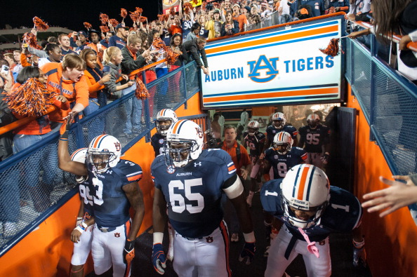 AUBURN, AL - NOVEMBER 10:  Players from the Auburn Tigers walk out of their tunnel before their game against the Georgia Bulldogs on November 10, 2012 at Jordan-Hare Stadium in Auburn, Alabama. Georgia defeated Auburn 38-0 and clinched the SEC East division. (Photo by Michael Chang/Getty Images)