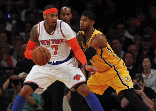 NEW YORK, NY - MAY 7:   Paul George #24 of the Indiana Pacers guards Carmelo Anthony #7 of the New York Knicks during Game Two of the Eastern Conference Semifinals of the 2013 NBA Playoffs at Madison Square Garden on May 7, 2013 in New York City. NOTE TO USER: User expressly acknowledges and agrees that, by downloading and/or using this photograph, user is consenting to the terms and conditions of the Getty Images License Agreement. (Photo by Jeff Zelevansky/Getty Images)