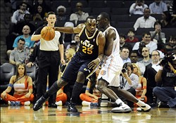 March 7, 2012; Charlotte, NC, USA; Utah Jazz center Al Jefferson (25) drives past Charlotte Bobcats center Bismack Biyombo (0) during the game at Time Warner Cable Arena. Mandatory Credit: Sam Sharpe-USA TODAY Sports