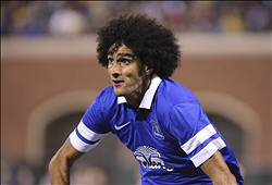 Jul 31, 2013; San Francisco, CA, USA; Everton midfielder Marouane Fellaini (25) chases down the ball against Juventus during the second half at AT&T Park. Everton defeated Juventus 6-5 on penalty kicks after tying 1-1 in regulation. Mandatory Credit: Kelley L Cox-USA TODAY Sports