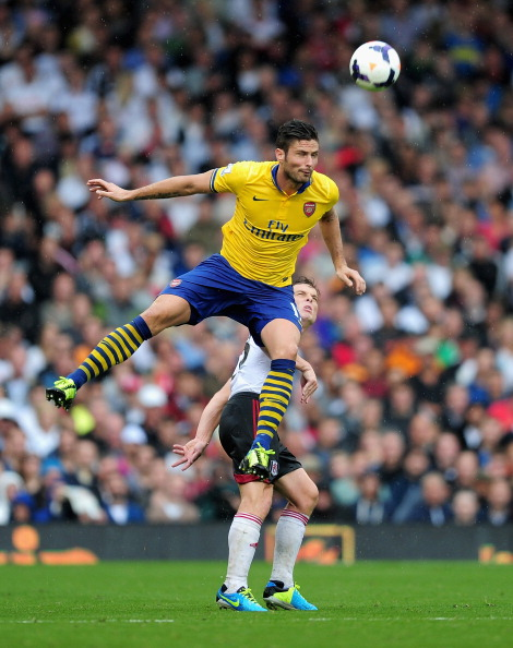 LONDON, ENGLAND - AUGUST 24:  Olivier Giroud of Arsenal jumps above Scott Parker of Fulham to head the ball during the Barclays Premier League match between Fulham and Arsenal at Craven Cottage on August 24, 2013 in London, England.  (Photo by Jamie McDonald/Getty Images)