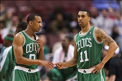 Mar 05, 2013; Philadelphia, PA, USA; Boston Celtics guard Avery Bradley (0) talks with guard Courtney Lee (11) during the third quarter against the Philadelphia 76ers at the Wells Fargo Center. The Celtics defeated the Sixers 109-101. Mandatory Credit: Howard Smith-USA TODAY Sports
