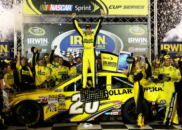 BRISTOL, TN - AUGUST 24:  Matt Kenseth, driver of the #20 Dollar General Toyota, celebrates in Victory Lane after winning the NASCAR Sprint Cup Series 53rd Annual IRWIN Tools Night Race at Bristol Motor Speedway on August 24, 2013 in Bristol, Tennessee.  (Photo by Jerry Markland/Getty Images)
