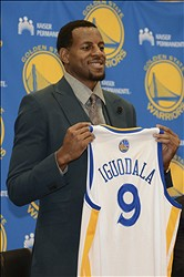 July 11, 2013; Oakland, CA, USA; Andre Iguodala poses for a photo in a press conference after a sign-and-trade deal to become a Golden State Warriors player at the Warriors Practice Facility. Mandatory Credit: Kyle Terada-USA TODAY Sports