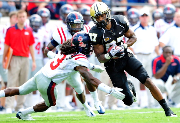 NASHVILLE, TN - SEPTEMBER 17:  Jordan Matthews #87 of the Vanderbilt Commodores breaks away from Charles Sawyer #3 of the Ole Miss Rebels at Vanderbilt Stadium on September 17, 2011 in Nashville, Tennessee.  (Photo by Grant Halverson/Getty Images)