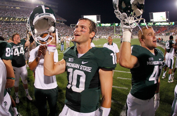 EAST LANSING, MI - AUGUST 31:  Andrew Maxwell #10 of the Michigan State Spartans celebrates a 17-13 victory over the Boise State Broncos with teammates and fans at Spartan Stadium on August, 2010 in East Lansing, Michigan. (Photo by Gregory Shamus/Getty Images)
