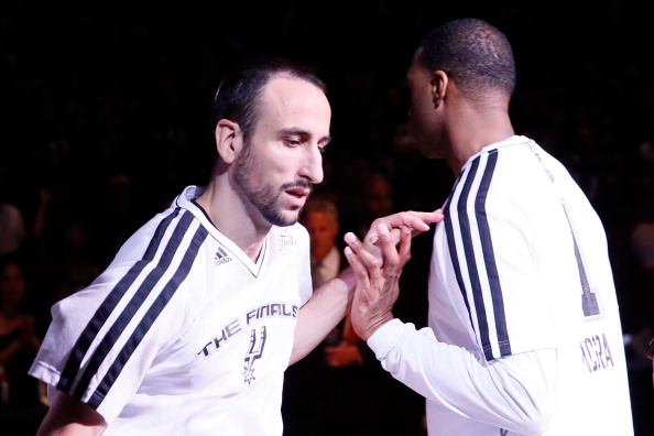 SAN ANTONIO, TX - JUNE 16:  Manu Ginobili #20 gives teammate Tracy McGrady #1 of the San Antonio Spurs a five during pre-game introductions before taking on the Miami Heat in Game Five of the 2013 NBA Finals at the AT&T Center on June 16, 2013 in San Antonio, Texas. NOTE TO USER: User expressly acknowledges and agrees that, by downloading and or using this photograph, User is consenting to the terms and conditions of the Getty Images License Agreement.  (Photo by Kevin C. Cox/Getty Images)