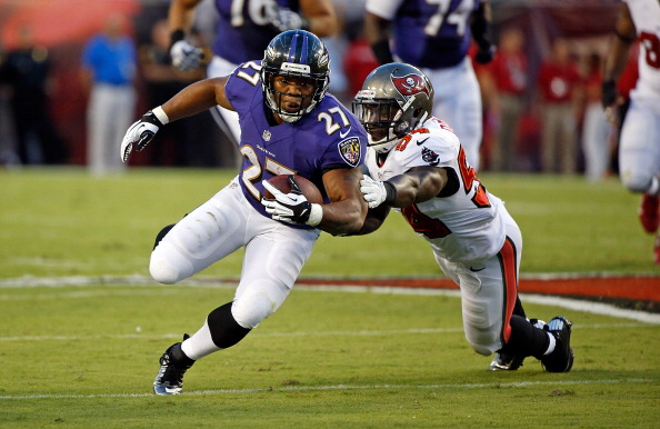 TAMPA, FL - AUGUST 08:  Running back Ray Rice #27 of the Baltimore Ravens is tackled by linebacker Lavonte David #54 of the Tampa Bay Buccaneers during a preseason game at Raymond James Stadium on August 8, 2013 in Tampa, Florida.  (Photo by J. Meric/Getty Images)