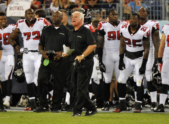 NASHVILLE, TN - AUGUST 24: Head coach Mike Smith of the Atlanta Falcons coaches his team against the Tennessee Titans  at LP Field on August 24, 2013 in Nashville, Tennessee.  (Photo by Frederick Breedon/Getty Images)