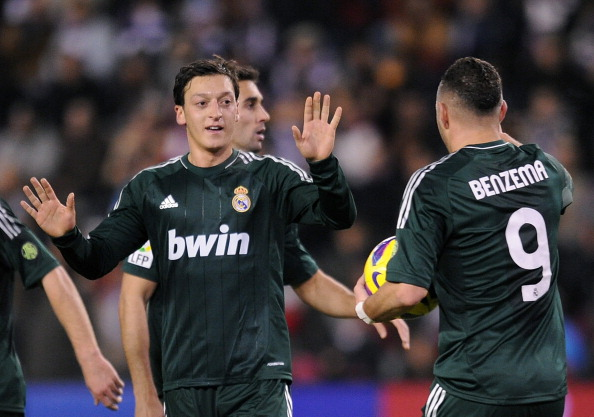 VALLADOLID, SPAIN - DECEMBER 08:  Mesut Ozil (L) of Real Madrid CF celebrates with Karim Benzema after scoring Real's 2nd goal during the La Liga match between Real Valladolid CF and Real Madrid CF at estadio Jose Zorrilla on December 8, 2012 in Valladolid, Spain.  (Photo by Denis Doyle/Getty Images)