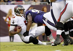 Aug 8, 2013; Tampa, FL, USA; Tampa Bay Buccaneers quarterback Josh Freeman (5) gets sacked by Baltimore Ravens defensive tackle Chris Canty (99) during the first quarter at Raymond James Stadium. Mandatory Credit: Kim Klement-USA TODAY Sports