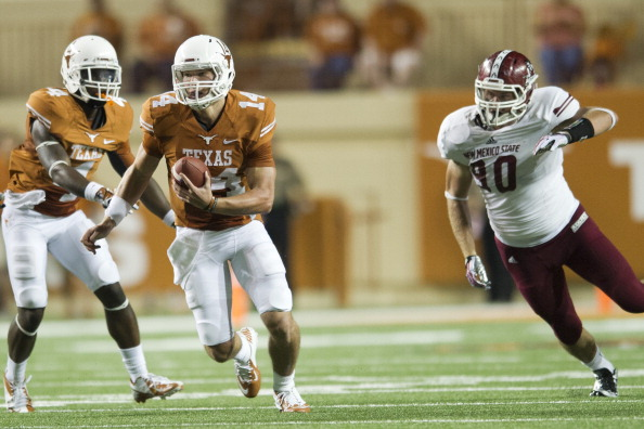 AUSTIN, TX - AUGUST 31: David Ash #14 of the Texas Longhorns breaks free from the New Mexico State Aggies on August 31, 2013 at Darrell K Royal-Texas Memorial Stadium in Austin, Texas. (Photo by Cooper Neill/Getty Images)