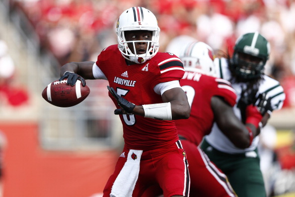LOUISVILLE, KY - SEPTEMBER 1: Teddy Bridgewater #5 of the Louisville Cardinals looks to pass the ball against the Ohio Bobcats during the game at Papa John's Cardinal Stadium on September 1, 2013 in Louisville, Kentucky. (Photo by Joe Robbins/Getty Images)
