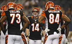 Aug 24, 2013; Arlington, TX, USA; Cincinnati Bengals quarterback Andy Dalton (14) in the huddle during a time out in the second quarter of the game against the Dallas Cowboys at AT&T Stadium. Mandatory Credit: Tim Heitman-USA TODAY Sports