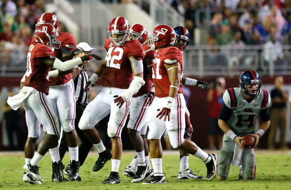 TUSCALOOSA, AL - SEPTEMBER 29:  Adrian Hubbard #42 of the Alabama Crimson Tide celebrates after tackling Bo Wallace #14 of the Mississippi Rebels at Bryant-Denny Stadium on September 29, 2012 in Tuscaloosa, Alabama.  (Photo by Kevin C. Cox/Getty Images)