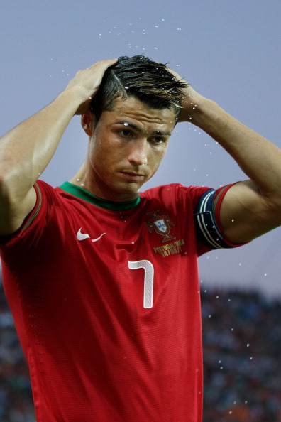 FARO, PORTUGAL - AUGUST 14:  Cristiano Ronaldo of Portugal brushes his hair with water prior to start the International Friendly match between Portugal and Netherlands at Estadio Algarve on August 14, 2013 in Faro, Portugal.  (Photo by Gonzalo Arroyo Moreno/Getty Images)
