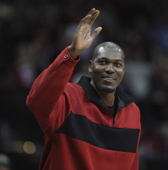 HOUSTON - DECEMBER 29:  Former Houston Rockets Hakeem Olajuwon waves to the crowd as he is introduced to the crowd at Toyota Center on December 29, 2010 in Houston, Texas.  NOTE TO USER: User expressly acknowledges and agrees that, by downloading and or using this photograph, User is consenting to the terms and conditions of the Getty Images License Agreement. (Photo by Bob Levey/Getty Images)
