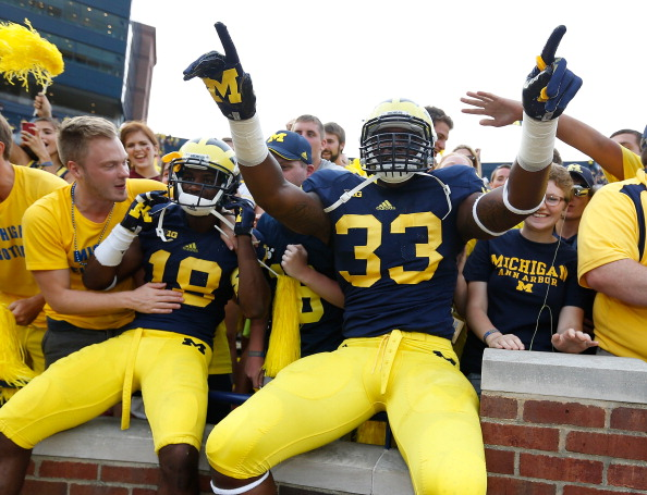 ANN ARBOR, MI - AUGUST 31: Taco Charlton #33 of the Michigan Wolverines and Blake Countess #18 celebrates a 59-9 win over the Central Michigan Chippewas at Michigan Stadium on August 31, 2013 in Ann Arbor, Michigan.  (Photo by Gregory Shamus/Getty Images)